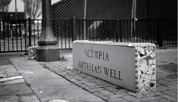 The Olympia Artesian Well cement block sign.