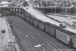 A coal train travels through downtown Tacoma